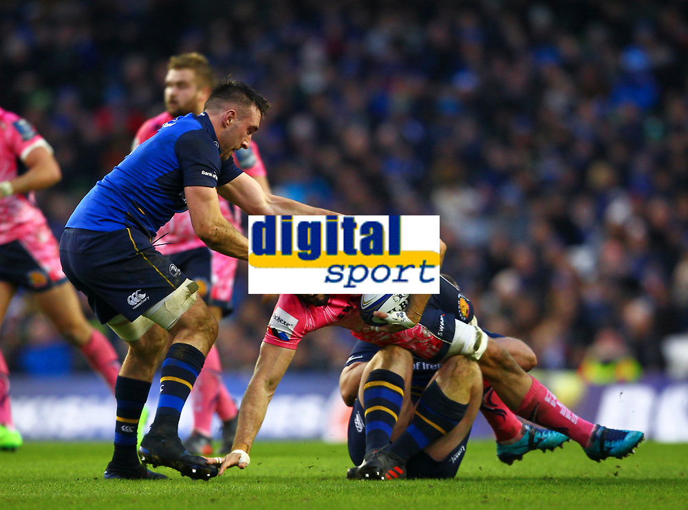 Rugby Union - 2017 / 2018 European Rugby Champions Cup - Pool Three: Leinster vs. Exeter Chiefs<br /> <br /> Exeter's Sam Simmonds is tackled by Leinster's Jack McGrath and Jack Conan, at Aviva Stadium, Dublin.<br /> <br /> COLORSPORT/KEN SUTTON