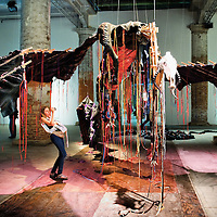 VENICE, ITALY - JUNE 02:  A general view of a woman taking a picture on an installation at the Arsenale on June 2, 2011 in Venice, Italy. This year's Biennale is the 54th edition and will run from June 4th until 27 November.