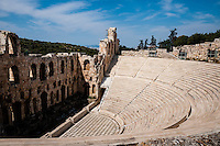 Greece, Athens. The Acropolis with several famous ancient strucures. The Odeon of Herodes Atticus is a stone theatre on the slopes of Acropolis.