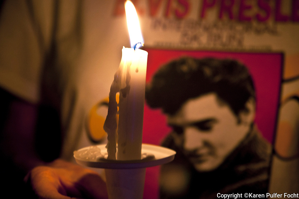 Police say about 30,000 fans participated in the Candlelight Vigil Saturday, at Elvis Presley's Memphis home, Graceland, according to Graceland officials. Fans lit candles, created shrines and sang Elvis songs before the gates opened. A ceremony began about 8:30 outside of the Graceland gates and many fans processed passed the grave of the King of Rock and Roll.