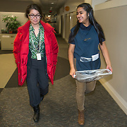 WASHINGTON, DC - DEC 11: Dinia Lovo Marquez, an 18-year-old senior at Bell Multicultural High School in Washington, DC,  walks down the hall at the Department of Education where she works as a janitor, with Gabriella Gomez, Assistant Secretary for Legislation and Congressional Affairs, at the Department of Education, December 11, 2013. Gomez is helping Dinia with her college applications. Dinia wants to be the first in her family to attend college. (Photo by Evelyn Hockstein/For The Washington Post)