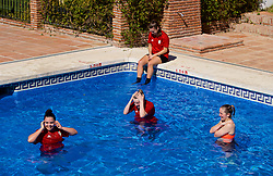 ALHAURÍN EL GRANDE, SPAIN - Tuesday, February 26, 2019: Wales players Tamsyn Sibanda, Kylie Nolan and Cori Williams cool off in the water of the hotel swimming pool during a training session at the at Alhaurin Golf Resort in Spain. (Pic by David Rawcliffe/Propaganda)
