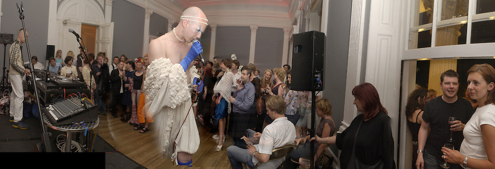 Minty performing.  Fergus Greer/ Leigh Bowery photographs. I.C.A. party. 18 July 2002. © Copyright Photograph by Dafydd Jones 66 Stockwell Park Rd. London SW9 0DA Tel 020 7733 0108 www.dafjones.com