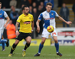 Bristol Rovers' Ollie Clarke in action against Burton Albion's Robbie Weir- Photo mandatory by-line: Matt Bunn/JMP - Tel: Mobile: 07966 386802 23/11/2013 - SPORT - Football - Burton - Pirelli Stadium - Burton Albion v Bristol Rovers - Sky Bet League Two