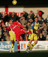 Photo: Lee Earle.<br /> Torquay United v Swindon Town. Coca Cola League 2. 18/11/2006. Swindon's Curtis Weston (L) goes in high on Kevin Hill.