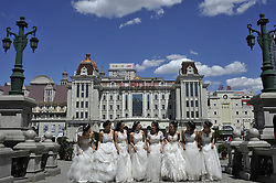June 8, 2017 - Harbin, China - Chinese college graduates wearing wedding dress at St. Sophia Cathedral in Harbin as they take their group graduation photograph at Harbin of China, 08 June 2017. The number of Chinese college graduates hit a historical high record reaching 7.95 million in 2017. (Credit Image: © Tao Zhang/NurPhoto via ZUMA Press)