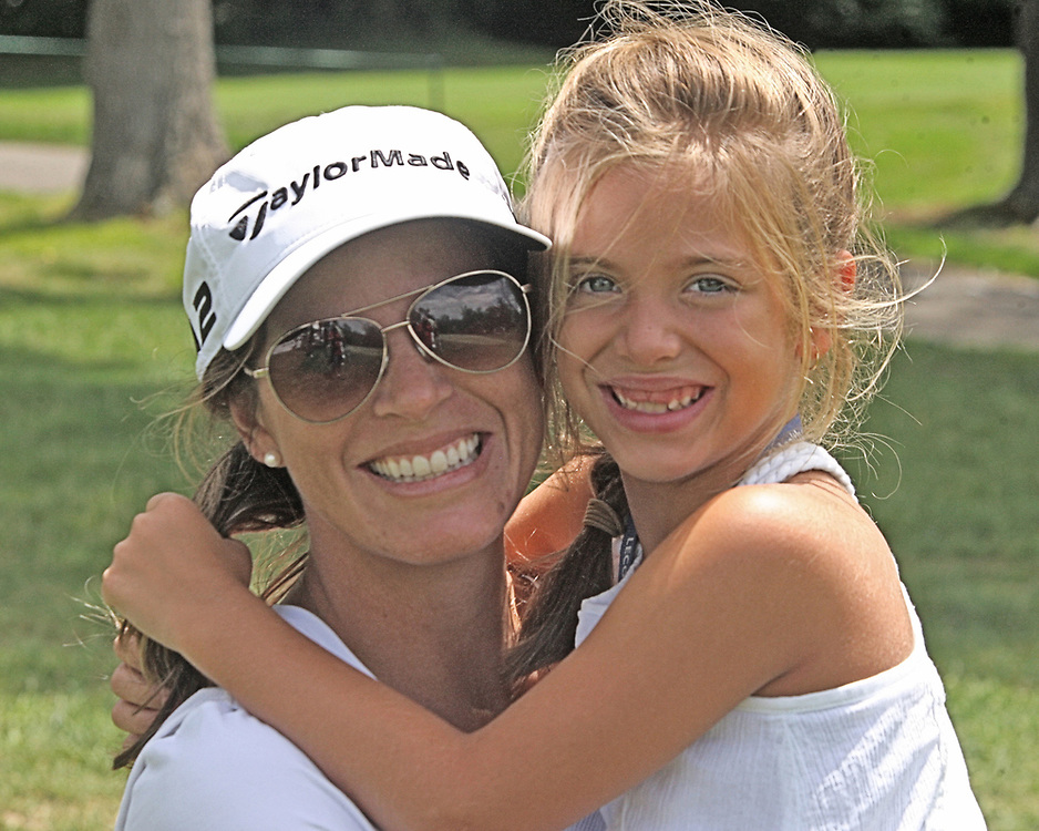 Beth Adams wife and caddy for golfer Blake Adams holds her daughter Libby after finishing the second round of golf during the LeCom Health Challenge Web.com PGA Tour at Peek n Peak July 7, 2017 photo by Mark L. Anderson  LeCom Health Challenge Web.com PGA Tour at Peek n Peak July 9, 2017 photo by Mark L. Anderson
