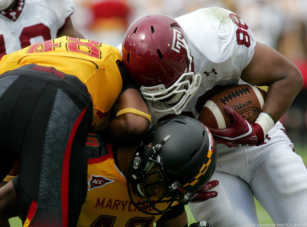 September 24, 2011; College Park, MD, USA; Temple Owls tight end Evan Rodriguez (88) is tackled by Maryland Terrapins defensive back Eric Franklin (48) and defensive back Matt Robinson (40) during first half at Byrd Stadium in College Park, Maryland. Brian Schneider-www.ebrianschneider.com