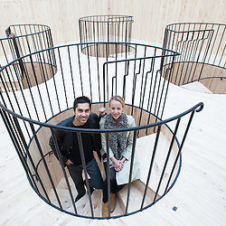 London, UK - 21 January 2014: Mauricio Pezo and Sofia von Ellrichshausen (Chile) pose next to their installation at the Sensing Spaces: Architecture Reimagined exhibition at the Royal Academy of Arts