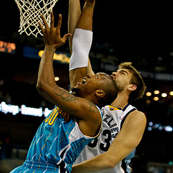 October 9, 2010; New Orleans, LA, USA; New Orleans Hornets power forward David West (30) shoots over Memphis Grizzlies center Marc Gasol (33) during the first quarter of a preseason game at the New Orleans Arena. Mandatory Credit: Derick E. Hingle
