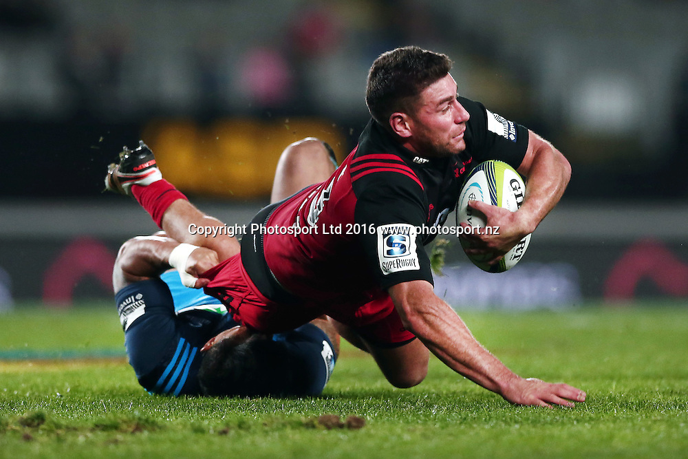 Kieron Fonotia of the Crusaders is tackled by Male Sa'u of the Blues. Super Rugby match, Blues v Crusaders at Eden Park, Auckland, New Zealand. 28 May 2016. Photo: Anthony Au-Yeung / www.photosport.nz