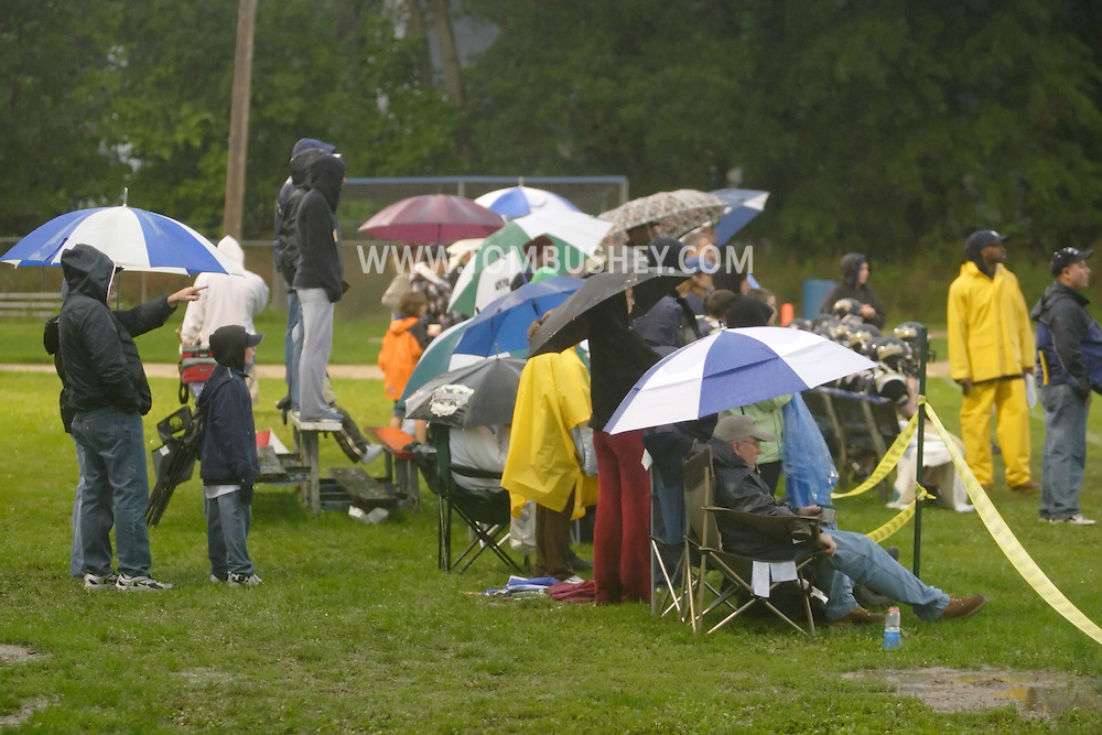 Middletown, N.Y. - Spectators watch a youth football game in the rain at Watts Park on Sept. 2, 2006. ©Tom Bushey / The Image Works