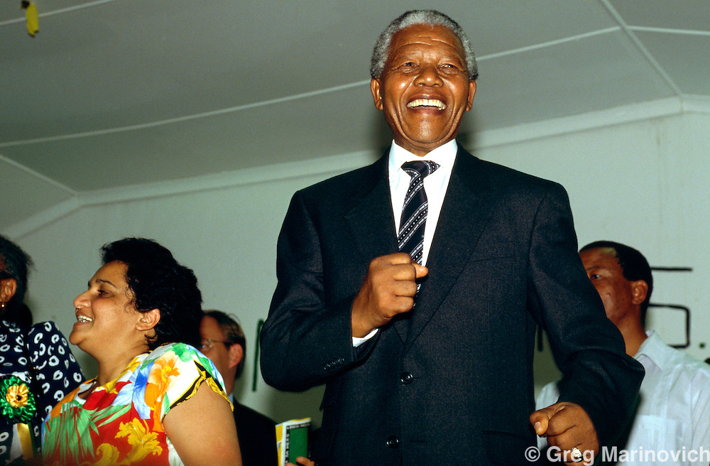 Nelson Mandela dances at a meeting, with Jesse uarte, Johannesburg, 1994, South Africa.