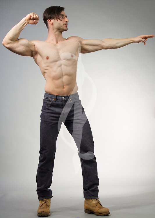 Male model posing in a contemporary outfit with a sword.