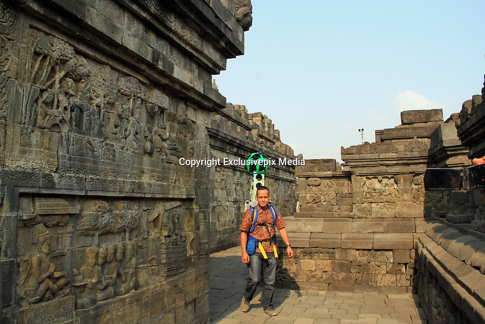 Sept. 27, 2015 - <br /> Google Maps Adds Street View of Borobudur Temple<br /> <br /> Eko Pramono, an operator holding a camera Street View Trekker down the temple of Borobudur is currently implemented by Google Maps image recording in the complex of Borobudur Tourism Park (TWCB) Magelang, Central Java, Sunday, September 27, 2015. Along with the World Tourism Day on 27 September 2015 Google marking the launch of the street view of Borobudur temple which is the majesty of the world can now be accessed through Google Maps also launched the Google Cultural Institute for Indonesia.<br /> &copy;Exclusivepix Media