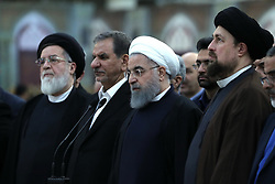 Iran's President Hassan Rowhani (C), Iranian Vice President Eshaq Jahangiri (2NDL) and Hassan Khomeini (R), the grandson of the founder of Iran's Islamic Republic Ayatollah Ruhollah Khomeini, at the shrine of the revolutionary leader Khomeini in southern Tehran on January 31, 2018 . Rouhani said that Iran must listen to protesters behind a recent wave of unrest, hinting that it risked another revolution if their demands were ignored. Photo by Parspix/ABACAPRESS.COM