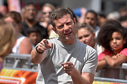 """© Licensed to London News Pictures. 21/07/2017. London, UK.  TV show host Dermot O'Leary greets fans outside Wembley Arena ahead of """"X Factor Bootcamp"""".   Photo credit : Stephen Chung/LNP"""