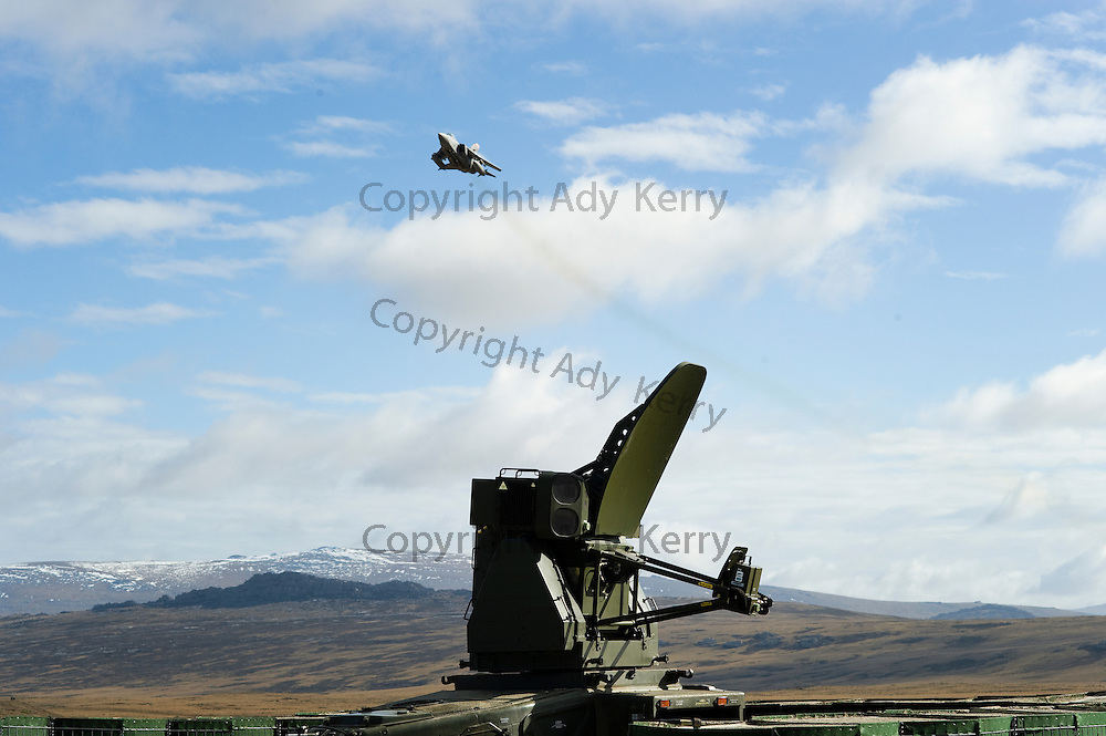 A Tornado F3 performs a firey cross manoeuvre past a Rapier battery on Poon Hill near the Mount Pleasant Complex on the Falkland Islands.  Tornados on QRA duty also provide training for rapier crews to practice their air defence skills. The Rapier batteries operated by 16 Regiment Royal Artillery provide air defence at other locations around the Falklands, 15th September 2009.