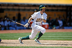 OAKLAND, CA - APRIL 17:  Billy Burns #1 of the Oakland Athletics hits a triple against the Kansas City Royals during the eighth inning at the Oakland Coliseum on April 17, 2016 in Oakland, California.  The Oakland Athletics defeated the Kansas City Royals 3-2. (Photo by Jason O. Watson/Getty Images) *** Local Caption *** Billy Burns