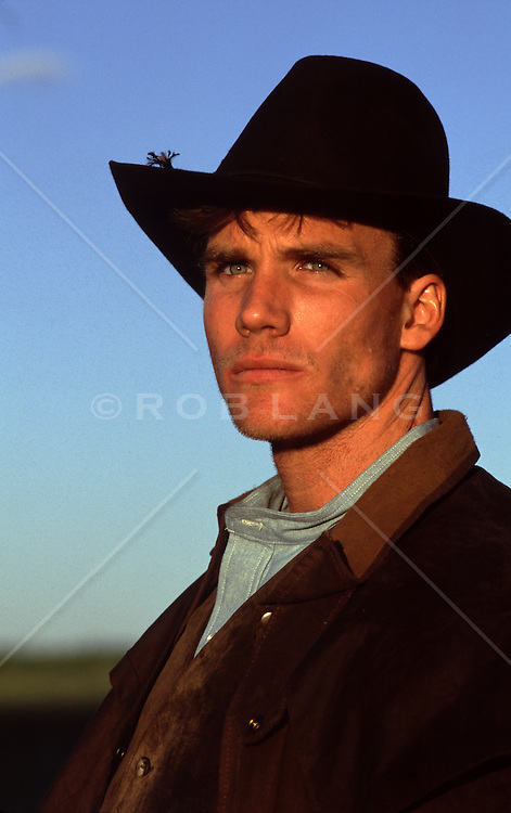 All American handsome cowboy at sunset