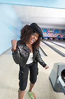 Young Woman Bowling