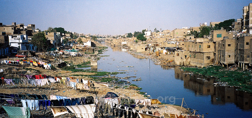 Pakistan, Karachi, 2004. River dwellers manage to eke out a living out near Karachi?s toxic and often dry waterways.