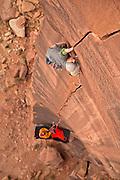 """Chris Kalous climbing """"Six Star Crack,"""" 13a, in Indian Creek Canyon, Southern Utah."""
