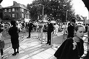 Policemen guarding the barriers, Notting Hill Carnival, London, 1989
