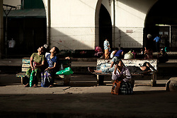 People waiting for a train at Yangon central station.
