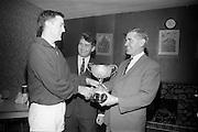 18/12/1965<br /> 12/18/1965<br /> 18 November 1965<br /> <br /> Presentation of Beamish & Carling Squash Trophies <br /> <br /> Mr. Peter Quinn President Old Belvedere Rugby Club, Presenting the Beamish Carling Squash Trophy to the winner of the Carling Black Label Tournament, Donal C. ByrneSquash Trophy to the winner of the Carling Black Label Tournament,   Donal C. Byrne, Sam Smyth Carling, Paddy Quinn President Old Belvedere Rugby
