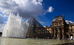 A general view of the pyramid entrance to The Louvre museum