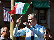 New York City Mayor Bill de Blasio waves an Italian flag as he marches in the Columbus Day Parade on Sunday, Oct. 11, 2015 in the Bronx, N.Y.