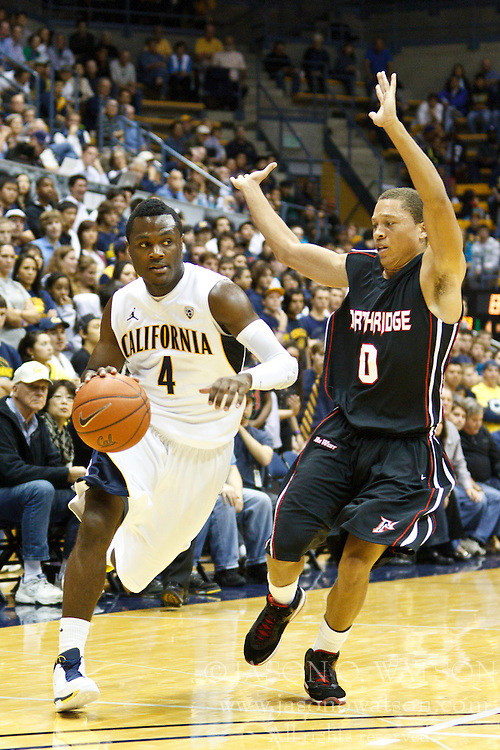 November 16, 2010; Berkeley, CA, USA;  California Golden Bears guard Gary Franklin (4) dribbles past Cal State Northridge Matadors guard Josh Greene (0) during the second half at Haas Pavilion.  California defeated Cal State Northridge 80-63.