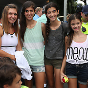 August 16, 2014, New Haven, CT:<br /> Simona halep poses for a photograph with box holders in the Baseline Tap House during WTA All-Access Hour on day three of the 2014 Connecticut Open at the Yale University Tennis Center in New Haven, Connecticut Sunday, August 17, 2014.<br /> (Photo by Billie Weiss/Connecticut Open)