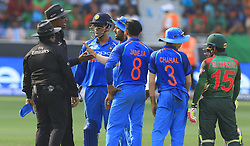 September 21, 2018 - Dubai, United Arab Emirates - Indian cricket captain Rohit Sharma is seen in a discussion with on-field umpires  during the 1st cricket match of the Super four group  of Asia Cup 2018 between India and Bangaldesh at Dubai International cricket stadium,Dubai, United Arab Emirates on 21 September 2018. (Credit Image: © Tharaka Basnayaka/NurPhoto/ZUMA Press)