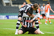 Notts County defender Elliott Hewitt (18) celebrates with Notts County defender Richard Duffy (5) after scoring a goal to make it 1-0 during the EFL Sky Bet League 2 match between Notts County and Blackpool at Meadow Lane, Nottingham, England on 29 April 2017. Photo by Jon Hobley.