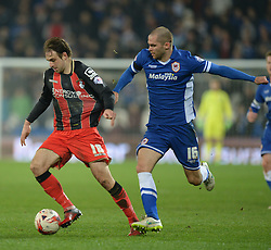 Cardiff City's Matthew Connolly pulls back Bournemouth's Brett Pitman shirt.  - Photo mandatory by-line: Alex James/JMP - Mobile: 07966 386802 - 17/03/2015 - SPORT - Football - Cardiff - Cardiff City Stadium - Cardiff City v AFC Bournemouth - Sky Bet Championship