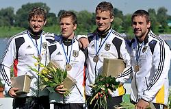 CHRIS WEND & TOMASZ WYLENZENK & RONALD VERCH & ERIK REBSTOCK (ALL GERMANY) POSE WITH THEIR BRONZE MEDALS IN MEN'S C4 1000 METERS FINAL A RACE DURING 2010 ICF KAYAK SPRINT WORLD CHAMPIONSHIPS ON MALTA LAKE IN POZNAN, POLAND...POLAND , POZNAN , AUGUST 21, 2010..( PHOTO BY ADAM NURKIEWICZ / MEDIASPORT ).