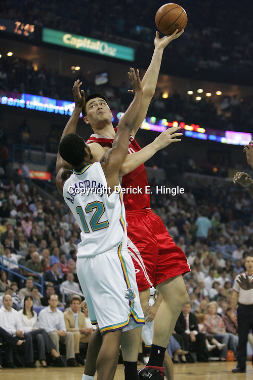 Yao Ming #11 of the Houston Rockets puts up a hook shot as Hilton Armstrong #12 of the New Orleans Hornets defends on February 22, 2008 at the New Orleans Arena in New Orleans, Louisiana.