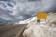 A sign warns truck drivers of a steep grade as they descend from Loveland Pass on US Highway 6 in Colorado. Loveland Pass is the site of the US Continental Divide.
