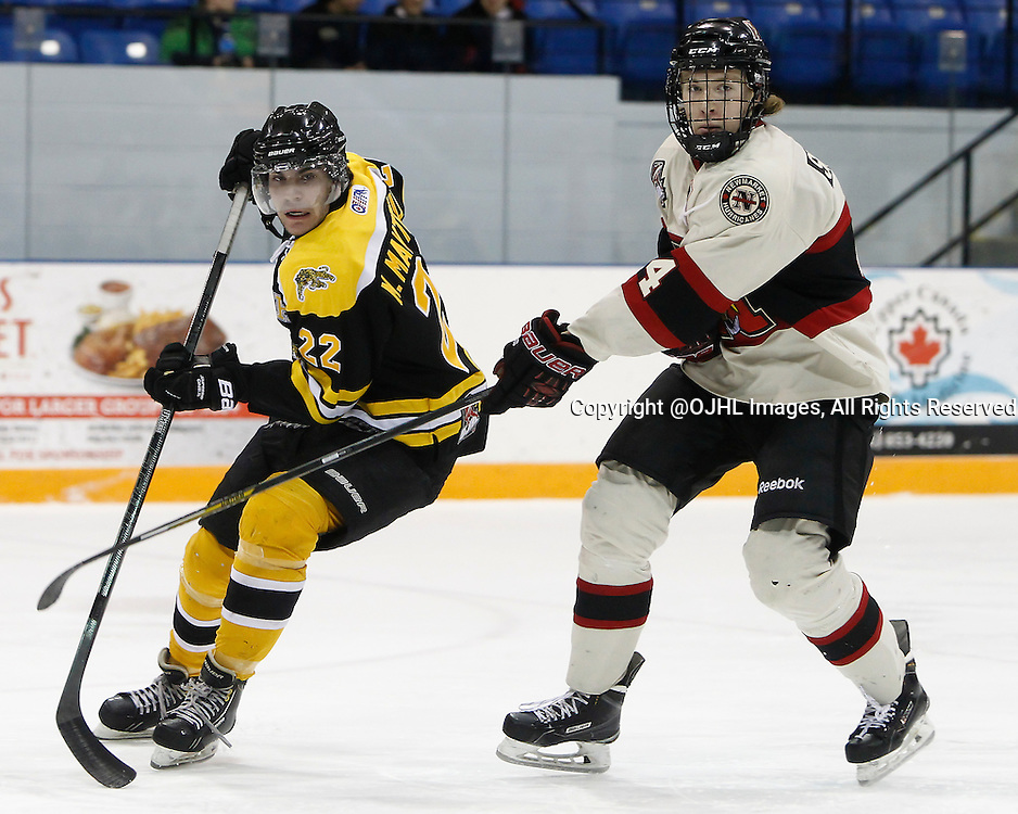 AURORA, ON - Mar 4, 2015 : Ontario Junior Hockey League game action between the Aurora Tigers and the Newmarket Hurricanes.  Game four of the best of seven series, Michael Mantenuto #22 battles with Adam Smith #4 in the third period.<br /> (Photo by Brian Watts / OJHL Images)