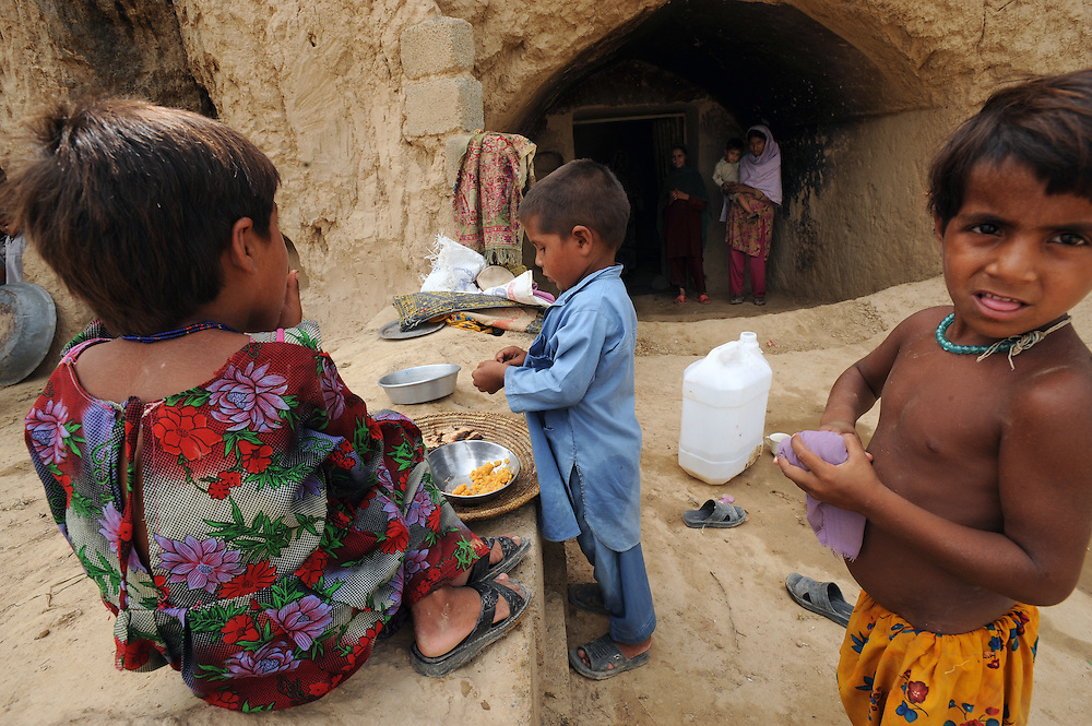 11/8/2009 Displaced families from the Swat valley who are living in caves in Haripur after being forced to flee their homes. Haripur, Pakistan. PHOTO KIM HAUGHTON
