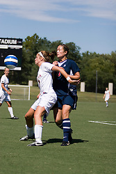 Virginia Cavaliers M/F Sinead Farrelly (17) fends off Arizona Wildcats MF Samantha Drees (3)..The Virginia Cavaliers women's soccer team defeated the Arizona Wildcats 4-0 in the 2007 Nike Soccer Classic at Klockner Stadium in Charlottesville, VA on September 16, 2007.  The Cavaliers won the tournament with a record of 2-0-0.