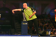 Michael van Gerwen throws the darts during the 2019 William Hill World Darts Championship Final at Alexandra Palace, London, United Kingdom on 1 January 2019.