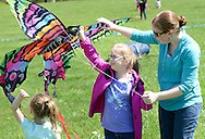 From left, Norah Allen, 3.5 years old, Lydia Allen, 10 years old and their mom, Aileen Allen all of Lansdale, Pennsylvania prepare to fly a kite during Kite Day Sunday April 24, 2016 at the Fonthill Museum in Doylestown, Pennsylvania. (Photo by William Thomas Cain/Cain Images)