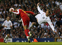Photo: Paul Thomas.<br /> England v Macedonia. UEFA European Championships 2008 Qualifying. 07/10/2006.<br /> <br /> Peter Crouch (10) of England tries a shot at goal but it's stopped by Nikolce Noveski.