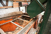 Staff members of the Ohio University Compost Facility focus on day to day activities to turn the university's food waste into usable soil. This compost facility is the largest in-vessel system at any college or university in the nation.