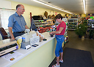Lynn Burrell (from left) of Marion talks with Gail Kennedy of Cedar Rapids as she purchases some flowers at Frontier Garden Center, 1941 Blairs Ferry Road NE, in Cedar Rapids, on Thursday, September 8, 2011.