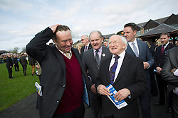 Repro Free: 23/04/2013 President Michael D. Higgins pictured speaking with Nicky Henderson prior to his horse Sprinter Sacre going on to win the Boylesport.com Champion Chase on the opening day of the Punchestown Raceing Festival. Pic Andres Poveda