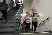 "Victoria Benjamin, center, of Bedford, NY, and Weina Zhao, right, of New York, smile as they near the finish of the New York City - Southern New York Chapter of the National Multiple Sclerosis Society's ""Climb to the Top,"" at Top of the Rock, Sunday, March 1, 2015, in New York.  (Photo by Diane Bondareff/Invision for Tishman Speyer/AP Images)"